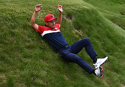Team USA's Xander Schauffele slides down the hill on his way to the podium after winning the Ryder Cup at the end of day three of the 43rd Ryder Cup at Whistling Straits, Wisconsin. Picture date: Sunday September 26, 2021.