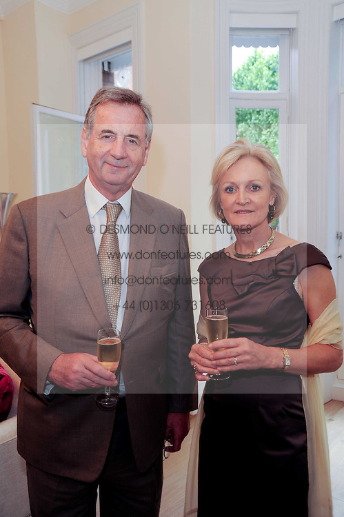 Leading plastic surgeon BRIAN MAYOU and his wife DR.SUSAN MAYOU at a reception to celebrate the repairs on the Queen Elizabeth Gate in Hyde Park after it's successful repair following damaged sustained in a traffic accident in early 2010.  The party was held at 35 Sloane Gardens, London on 7th June 2010.