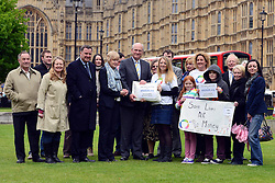 © Licensed to London News Pictures. 14/05/2013. Westminster, UK Nick Harvey MP (centre) accepts the petition.  Patients campaigning for a life-saving treatment to be made available for all sufferers of the rare blood disease atypical Haemolytic Uraemic Syndrome (aHUS) present an urgent petition with over 30,000 signatures to MPs at the House of Commons on Tuesday May 14 2013... Photo credit : Stephen Simpson/LNP