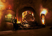 Peter Menzel and Faith D'Aluisio in their cave. Napa Valley, California, USA. ((PRIV)).