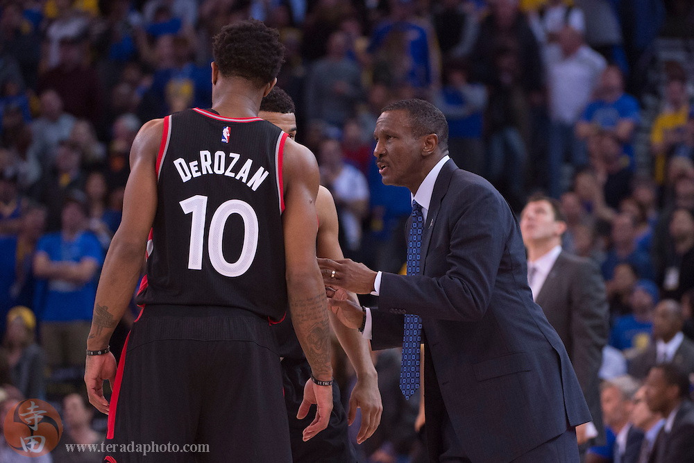 November 17, 2015; Oakland, CA, USA; Toronto Raptors head coach Dwane Casey (right) instructs guard DeMar DeRozan (10) during the fourth quarter against the Golden State Warriors at Oracle Arena. The Warriors defeated the Raptors 115-110.