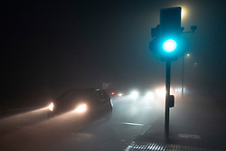 © Licensed to London News Pictures. 09/10/2021. London, UK. Motorists drive during heavy fog on Blackheath Common in South East London. A yellow weather warning for fog is in place in parts of London and South East England.  Photo credit: George Cracknell Wright/LNP