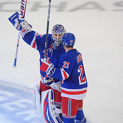 New York Rangers goalie Henrik Lundqvist (30) celebrates his shutout victory with center Derek Stepan (21) during third period NHL action between the Winnipeg Jets and the New York Rangers at Madison Square Garden in New York, N.Y. The Rangers defeated the Jets 3-0.