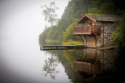 © Licensed to London News Pictures. 14/09/2016. Pooley Bridge UK. Picture shows a boat house on the banks of Ullswater Lake in the morning mist near Pooley Bridge this morning. After last nights thunderstorms in the north of England Cumbria woke to a calm but misty morning. Photo credit: Andrew McCaren/LNP