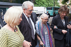 London June 16th 2014. Entertainer and artist Rolf Harris arrives at court in London withg his daughter Bindi, left, his wife Alwen and his niece Jenny, right, as his trial nears its conclusion, with the defence's closing speech expected to take place.