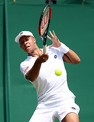 Jay Clarke in action on day two of the Wimbledon Championships at the All England Lawn Tennis and Croquet Club, Wimbledon.