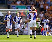Photo. Jed Wee<br /> Blackburn Rovers v Wolverhampton Wanderers, FA Barclaycard Premiership, Ewood Park, Blackburn. 16/08/2003.<br /> Blackburn's David Thompson jumps onto team mate Vratislav Gresko in celebration after scoring.