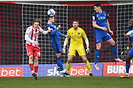 Stevenage midfielder Arthur Read (19) and Carlisle United defender Joe Riley (7) challenges for a header  during the EFL Sky Bet League 2 match between Stevenage and Carlisle United at the Lamex Stadium, Stevenage, England on 20 March 2021.