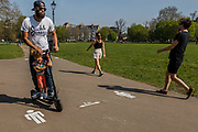 Good Friday - Clapham Common is pretty quiet after Lambeth Council  taped up all the benches, put signs out and painted reminders of the 2m distancing on the paths. The 'lockdown' continues for the Coronav. The 'lockdown' continues for the Coronavirus (Covid 19) outbreak in London.