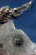 (LOW-RES) Aerial landscape of the Bay of Naples and the Vesuvius volcano, shot from the International Space Station by Commander Chris Hadfield. Used by permission from the author in the chapter entitled 'Under the Volcano' and from the book 'Risk Wise: Nine Everyday Adventures' by Polly Morland (Allianz, The School of Life, Profile Books, 2015).