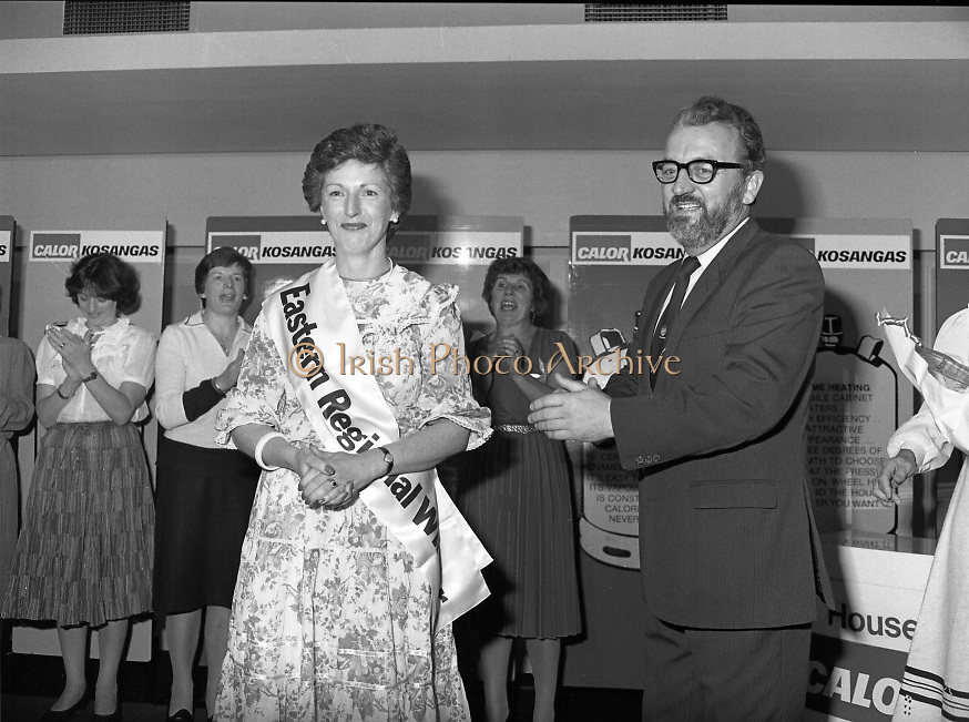 """Calor Kosangas Housewife of the Year - Dublin Regional Final.26/10/1982  26.10.1982..""""Calor Kosangas Housewife Of The Year 1982"""". Dublin Regional Final..The final was held in the Gresham Hotel,O'Connell St,Dublin. The winner was Mrs.,Deirdre Ryan,Derrypatrick,Drumree,Co Meath..Mr Michael Higgins ,Marketing and General Sales Manager,Calor Kosangas congratulates the winning housewife, Mrs.Deirdre Ryan, derrypatrick,Drumree,Co Meath"""