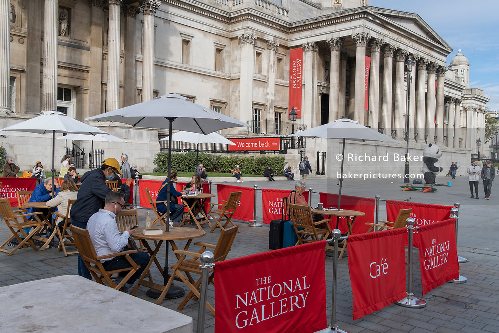 Tables are set for National Gallery cafe customers, now set outdoors on the pavement in Trafalgar Square during the second (Autumn) spike of the Coronavirus pandemic, on 5th October 2020, in London, England.