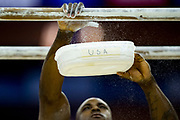 Donnell Whittenburg of the United States of America (USA) puts extra chalk on the Parallel bars during the iPro Sport World Cup of Gymnastics 2017 at the O2 Arena, London, United Kingdom on 8 April 2017. Photo by Martin Cole.