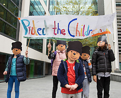 © Licensed to London News Pictures. 24/10/2016. London, UK. Children dressed as Paddington Bear at a demonstration outside the Home Office to demand that the government move children from the Calais 'Jungle' camp in France to the United Kingdom. French authorities have begun the demolition of the camp. Photo credit: Rob Pinney/LNP