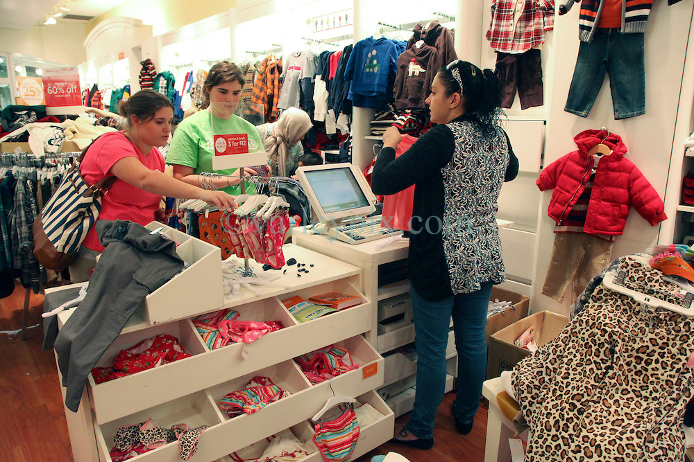 23 November 2012. New Orleans, Louisiana,  USA. <br /> Black Friday. Shoppers descend on children's clothes at Gymboree as prices are slashed for the traditional post Thanksgiving shopping frenzy.<br /> Photo; Charlie Varley/varleypix.com