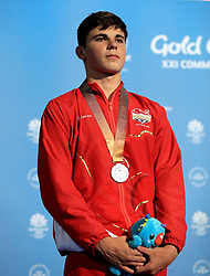 England's Matthew Dixon celebrates with his silver medal in the Men's 10m Platform Final at the Optus Aquatic Centre during day ten of the 2018 Commonwealth Games in the Gold Coast, Australia.