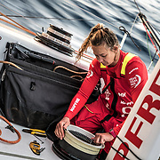 Leg 01, Alicante to Lisbon, day 01, Start on board MAPFRE. Sophie fixing a winch. Photo by Ugo Fonolla/Volvo Ocean Race. 22 October, 2017