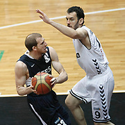 Besiktas's Bekir YARANGUME (R) and Efes Pilsen's Sinan GULER (L) during their Turkish Basketball league derby match Besiktas between Efes Pilsen at the BJK Akatlar Arena in Istanbul Turkey on Saturday 30 April 2011. Photo by TURKPIX