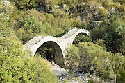 Ancient stone bridge Zagori, Pindus mountains, Epirus, Greece.