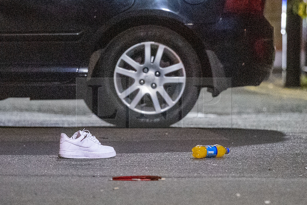 © Licensed to London News Pictures. 20/07/2020. London, UK. A shoe sits on the ground in front of a damaged vehicle inside a crime scene in Bethnal Green. An investigation has been launched after a person was rammed by a car in Bethnal Green, the person was rammed by the vehicle into a fence. Photo credit: Peter Manning/LNP