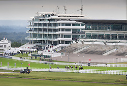 © Licensed to London News Pictures. 04/07/2020. Epsom, UK. Empty grand stands greet the riders in The Investec Oaks on Derby Day at Epsom, Surrey. Today's race meeting is being held behind closed doors due to the coronavirus lockdown rules. Seven races are being held in one day including The Oaks, with The Derby being run at 4:55pm. Photo credit: Peter Macdiarmid/LNP