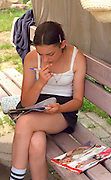 Girl age 14 working crossword puzzle.  Chechocinek Poland