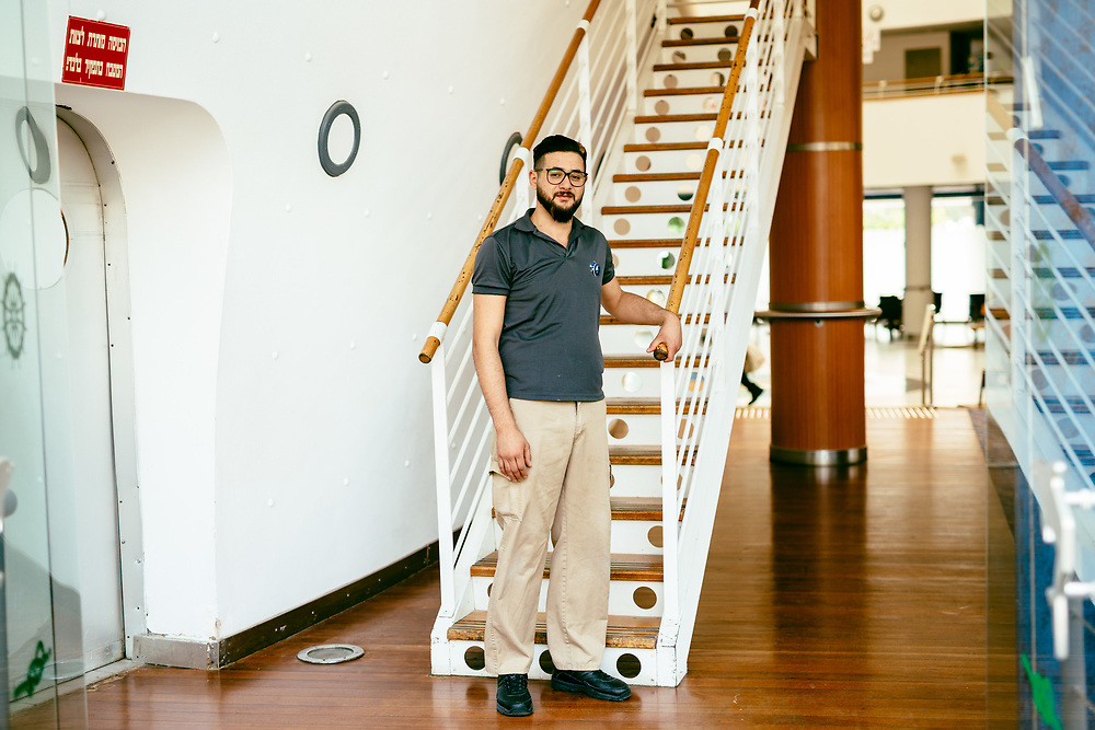 Yazan Sawen, 20, a Jordanian employee from Amman, poses for a portrait at Club Hotel Eilat, a suites hotel in Eilat, southern Israel, on March 15, 2018.