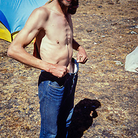John Fischer shows off his weight loss after the expedition.