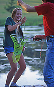 Daughter catches fish on farm pond, York Co., PA