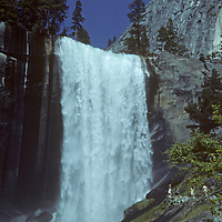 Hikers scramble along the Mist Trail below Vernal Falls, a classic hike in California's Yosemite National Park.
