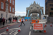A Road Closed sign on the southern end of London's Tower Bridge, closed for repairs to traffic and disrupting this major Thames crossing and surrounding roads for the next three months.