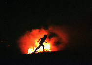 People jump over a San Juan bonfire on June, 23rd 1998 at the Basque Country. Jumping over the bonfires is a tradition to celebrate the summer solstice and are used as ancient  rituals of regeneration. (Ander Gillenea / Bostok Photo)