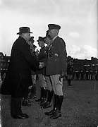 11/04/1960<br /> 04/11/1960<br /> 11 April 1960<br /> The United Nations Medal was presented to 47 Officers of the Irish Army who served in U.N.O. forces in 1959/60,by the Taoiseach Sean Lemass at a ceremony at Collin's Barracks, Dublin. <br /> Picture shows: The Taoiseach congratulating Captain Henry Goldsborough of the Southern Command.