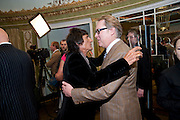 RONNIE WOOD; VIC REEVES, The South Bank Sky Arts Awards , The Dorchester Hotel, Park Lane, London. January 25, 2011,-DO NOT ARCHIVE-© Copyright Photograph by Dafydd Jones. 248 Clapham Rd. London SW9 0PZ. Tel 0207 820 0771. www.dafjones.com.