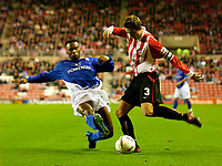 Photo. Jed Wee.<br /> Sunderland v Ipswich Town, Nationwide League Division One, Stadium of Light, Sunderland. 30/09/2003.<br /> Ipswich's Fabian Wilnis (L) slides in to try to stop Sunderland's George McCartney.