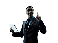 one caucasian business man standing using digital tablet  silhouette isolated on white background