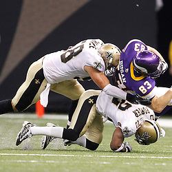 September 9, 2010; New Orleans, LA, USA;  New Orleans Saints cornerback Tracy Porter (22) and linebacker Scott Shanle (58) combine to tackle Minnesota Vikings tight end Jeff Dugan (83) during first half of the NFL Kickoff season opener at the Louisiana Superdome. Mandatory Credit: Derick E. Hingle