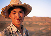 Young shepherd with Great wall at yanchi. Ningxia Province, China.