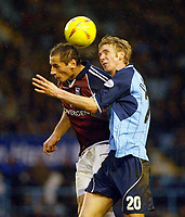 Photo: Scott Heavey.<br />Coventry City v Ipswich Town. Nationwide Division One. 31/01/2004.<br />Calum Davenport and Shefki Kuqi both head the ball in the air