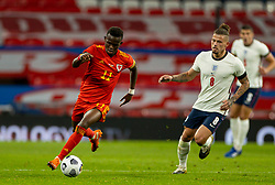 LONDON, ENGLAND - Thursday, October 8, 2020: Wales' Rabbi Matondo (L) and England's Kalvin Phillips during the International Friendly match between England and Wales at Wembley Stadium. The game was played behind closed doors due to the UK Government's social distancing laws prohibiting supporters from attending events inside stadiums as a result of the Coronavirus Pandemic. England won 3-0. (Pic by David Rawcliffe/Propaganda)