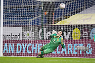 Milton Keynes Dons goalkeeper Lee Nicholls (1) fail to save Burnley midfielder Dale Stephens (16) penalty during the FA Cup match between Burnley and Milton Keynes Dons at Turf Moor, Burnley, England on 9 January 2021.