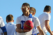 Reflection in the sunglasses of Brighton & Hove Albion central midfielder Beram Kayal during the Brighton & Hove Albion Football Club Promotion Parade at Brighton Seafront, Brighton, East Sussex. United Kingdom on 14 May 2017. Photo by Ellie Hoad.