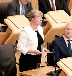 """First Minister's Questions in the Scottish Parliament<br /> <br /> Thursday, 19th September 2019<br /> <br /> Pictured: Shona Robinson<br /> <br /> HOLYROOD MARKS FIRST ANNIVERSARY OF SOCIAL SECURITY SCOTLAND<br />  <br /> """"FAIRNESS, DIGNITY AND RESPECT"""" NOW AT HEART OF SYSTEM<br />  <br /> The Scottish Parliament celebrated the first anniversary of Social Security Scotland, in a debate led by SNP MSP Shona Robison.<br />  <br /> The agency made its first payments in September 2018, delivering the Carer's Allowance Supplement – which has helped around 77,500 people - and the Best Start Grant - which has supported almost 10,000 low-income families.<br />  <br /> Social Security Scotland will also deliver a new £10 Scottish Child Payment - described as a """"game changer"""" by anti-poverty campaigners and estimated to lift 30,000 children out of poverty – ahead of schedule in 2020.<br />  <br /> Speaking in the debate, Shona Robison MSP said:<br />  <br /> """"It was a proud moment for me when this parliament passed the Social Security (Scotland) Bill. <br />  <br /> """"It was a proud moment for all of us who want to see a fairer, more respectful and dignified Scotland.<br />  <br /> """"The first year has been a success – bringing over 700 jobs to my constituency in Dundee, and delivering face to face support to those who need it.<br />  <br /> """"Let's not forget the words of the UN's Special Rapporteur on extreme poverty and human rights who said that UK Government compassion for those who are suffering has been replaced by a punitive, mean-spirited, and often callous approach to welfare.<br />  <br /> """"And to that end, I echo Social Security Secretary Shirley-Anne Somerville when she calls for all social security to be devolved to Scotland to create a system with the people of Scotland for the people of Scotland.'' <br />  <br /> """"The UN letter declares that the poverty is a political choice.Let's choose to end poverty.""""<br />  <br /> ENDS<br /> <br /> Notes:<br />  <br /> Membe"""