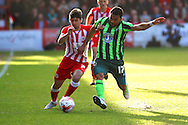 Andy Barcham of AFC Wimbledon challenges Piero Mingoia of Accrington Stanley FC during the Sky Bet League 2 play-off second leg match between Accrington Stanley and AFC Wimbledon at the Fraser Eagle Stadium, Accrington, England on 18 May 2016. Photo by Pete Burns.