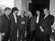 U2 Meet An Taoiseach, Charles Haughey.    (R58)..1987..18.05.1987..05.18.1987..18th May 1987..After their highly successful tour of America, An Taoiseach, Charles Haughey welcomed U2 back to Ireland with a reception held in Iveagh House, Dublin. Iveagh House formerly a home to the Guinness family is now held by the Department of Foreign Affairs...U2 and An Taoiseach pose for the cameras; (L-R),.Larry Mullen, 'The Edge' (Dave Evans),Charles Haughey, 'Bono' (Paul Hewson) and Adam Clayton. U2 manager, Paul McGuinness completes the line up.