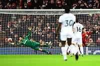 Liverpool's Georginio Wijnaldum scores his side's first goal past the dive of West Ham United's Lukasz Fabianski<br /> <br /> Photographer Richard Martin-Roberts/CameraSport<br /> <br /> The Premier League - Liverpool v West Ham United - Monday 24th February 2020 - Anfield - Liverpool<br /> <br /> World Copyright © 2020 CameraSport. All rights reserved. 43 Linden Ave. Countesthorpe. Leicester. England. LE8 5PG - Tel: +44 (0) 116 277 4147 - admin@camerasport.com - www.camerasport.com