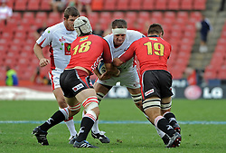 JOHANNESBURG, South Africa, 02 April 2011. Adam Wallace-Harrison of the Reds is stopped by Michael Rhodes and Derick Minnie of the Lions during the Super15 Rugby match between the Lions and the Reds at Coca-Cola Park in Johannesburg, South Africa on 02 April 2011. .Photographer : Anton de Villiers / SPORTZPICS
