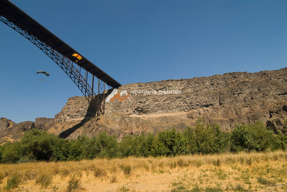 Base jumpers jumping during the Perrine Bridge Festival on the Snake River in Twin Falls, Idaho.