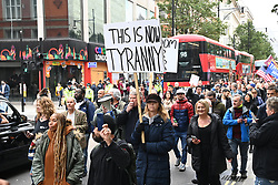 © Licensed to London News Pictures. 17/10/2020. London, UK. Protesters take part in the March For Freedom demonstration organised by Stand Up X. The group are against the Covid-19 restrictions including the wearing of face masks and the erosion of civil liberties. London, UK. Photo credit: Ray Tang/LNP