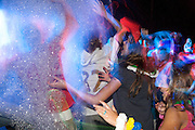 teenagers enjoy a foam party